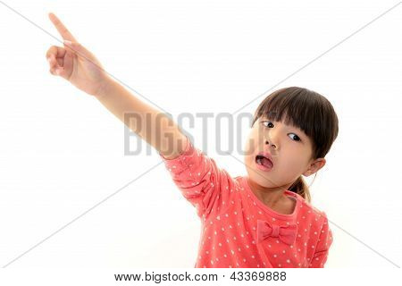 Little Asian girl pointing.