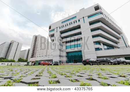Office building and parked cars