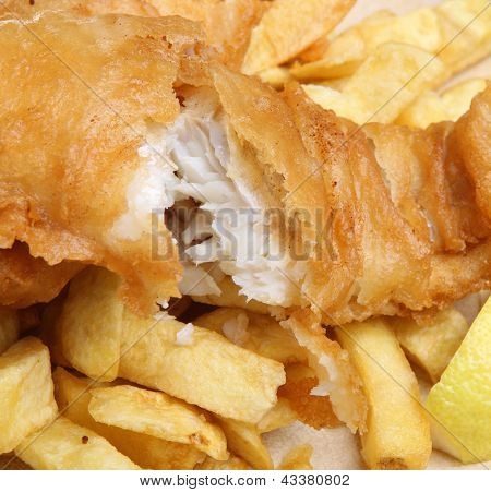 Battered cod fish fillet and chunky chips.