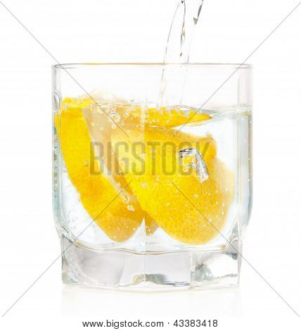 A Glass Of Cold Drink With A Lemon From The Fridge. On A White Background.