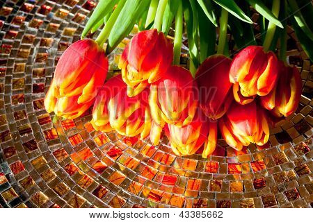 Red Tulips  On Mosaic Table.