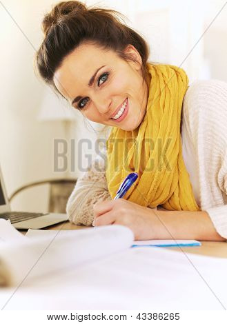Cheerful Woman Writing In Her Journal