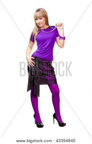 Beautiful girl in purple clothes with silver necklace and black shoes