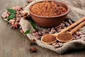 picture of cocoa beans  - Cocoa powder and cocoa beans  on wooden background - JPG