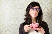 stock photo of thought  - Casual woman thinking and looking pensive on retro vintage background - JPG
