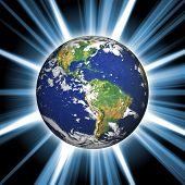 picture of planet earth  - Our planet earth with a bright star burst coming from behind - JPG
