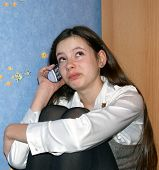 Teen Girl Talking On A Phone