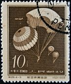 A stamp printed in china shows Parachute jump