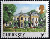 A stamp printed in Guernsey shows Hostel of St John