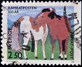 A stamp printed in Sweden shows children's drawings Horses circa 1992