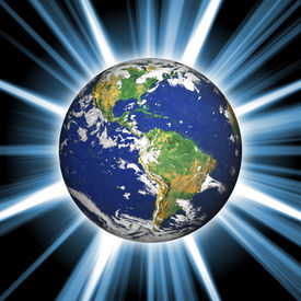 stock photo of planet earth  - Our planet earth with a bright star burst coming from behind - JPG