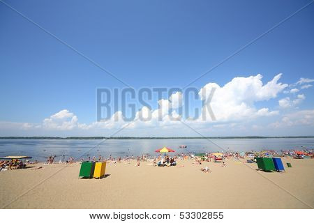 Vacationers sunbathe on the sandy beach of the river Volga in Samara