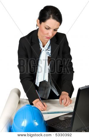 Engineer Woman Work In Office And Drawing Plans