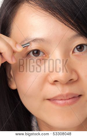 Woman Plucking Eyebrows
