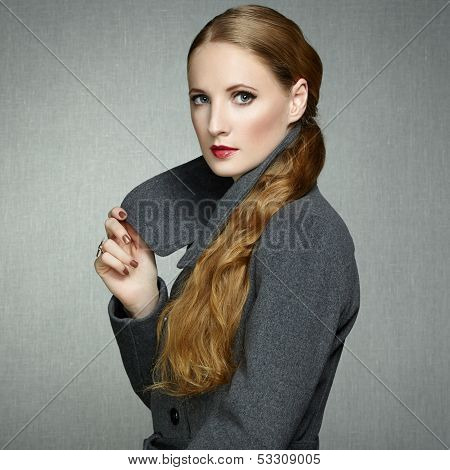 Portrait Of Young Woman In Autumn Coat