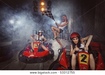 girl is driving Go-kart with speed in Karting