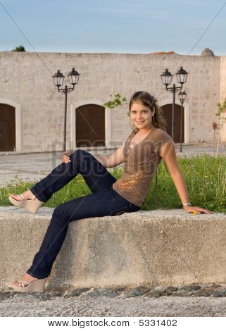 Girl With Blue Jeans Sitting And Relaxing