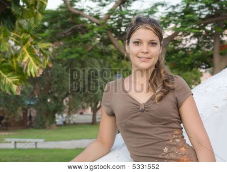 Girl Smiling In A Park