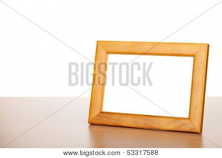 Photo frame on wood table. Isolated on white background