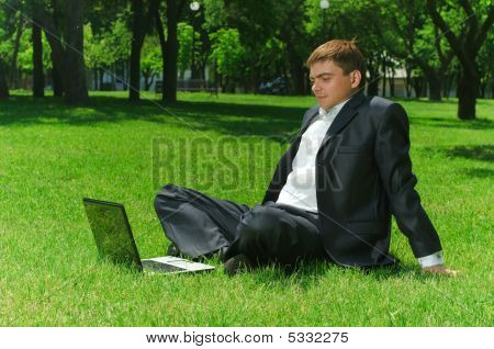 Young Businessman In The Park