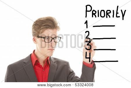 Young Man Writing Priority Items Isolated On White Background