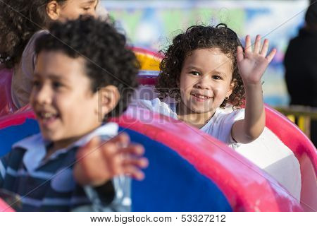 Happy Young Girl At Amusement Park