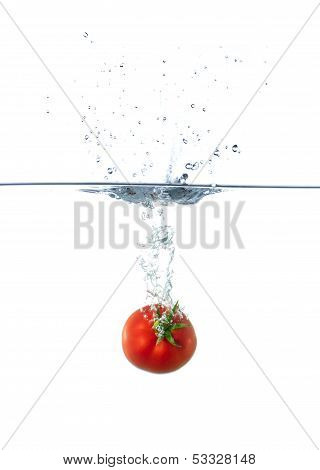 Fresh Red Tomato Sinking In Water