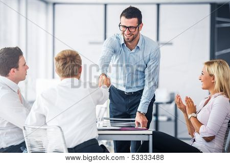 Corporate people shaking hands on a office meeting