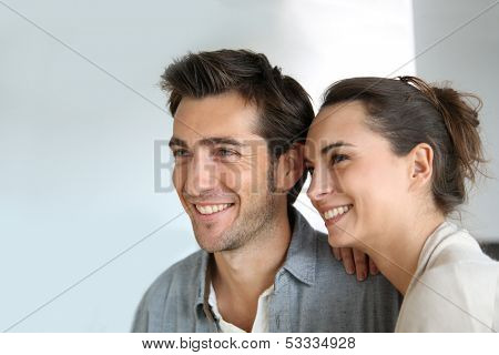 Cheerful couple looking towards their future