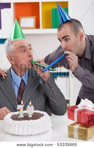 Senior father celebrating 70th birthday with his son