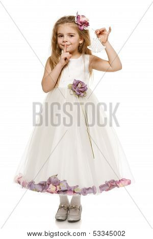 Girl in princess dress holding Xmas bells