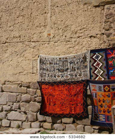 Colorful Textiles On Stucco Wall