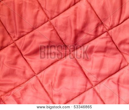 Closeup Background Texture Of Quilted Red Blanket Fabric