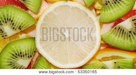 Fruit background from a lemon, orange, grapefruit and kiwi