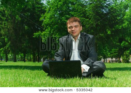 Businessman In The Park On Grass