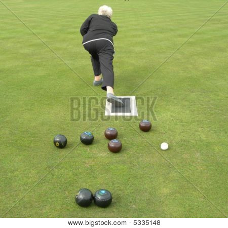 Lady Bowler Delivering Bowl On Bowling Green