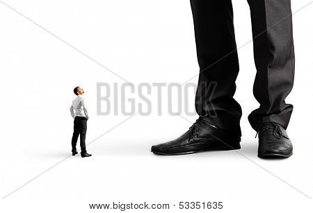 small businessman looking at his big boss. isolated on white background