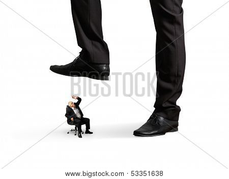 scared senior businessman under big leg his boss. isolated on white background