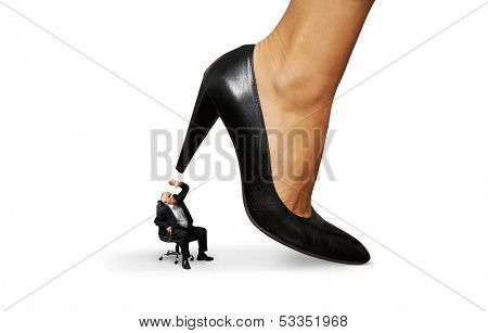 concept photo of senior man under big female heel. isolated on white background