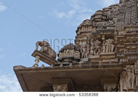 Sculptor At Top Of Vishvanatha Temple, Khajuraho, India - UNESCO world heritage site.