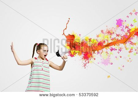 Image of little cute girl screaming angrily in megaphon
