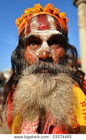 Holy sadhu man begging