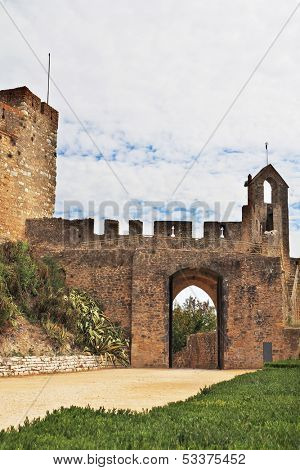The entrance to the fortress of the Knights Templar. Fortress protective wall surrounding the dilapidated medieval castle Templar
