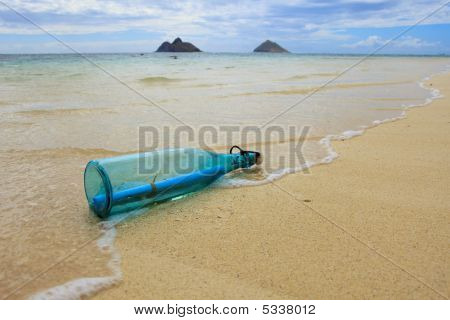 Glass Bottle With A Message Inside Drifts Ashore