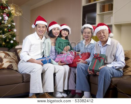 Asian Family With Christmas Hats