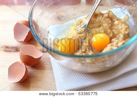 Mix Of Banana And Eggs In A Glass Bowl