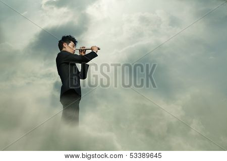 Young businessman looking through telescope