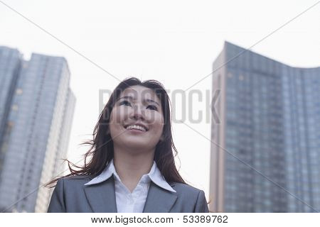 Portrait of young businesswoman outdoors
