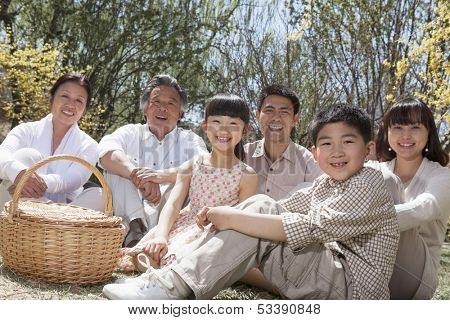 Portrait of multi-generational family having picnic