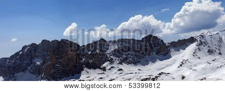 Panorama Of Snowy Mountains In Spring Sunny Day
